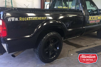 A rockstar energy sponsor truck shining in the lights after an exterior detail.