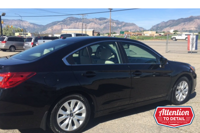A well-detailed black car showcased in front of the Ogden mountains after an exterior detail.